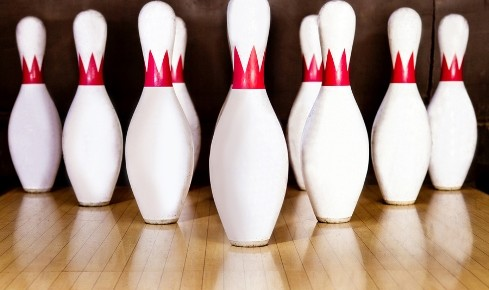 bigstock-Pins-at-the-end-of-a-bowling-a-29869001